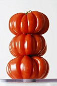 Three Organic Heirloom Tomatoes Stacked; White Background