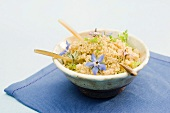Bowl of quinoa, garnished with flower