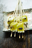 Grilled tofu on wooden skewers topped with miso and sansho