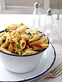 Penne primavera with tomatoes, spring onions and herbs
