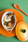 Oeufs cocotte with herbs, spices and bread sticks