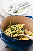 Penne with asparagus and saffron in a pot