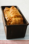 Fruit cake with ginger in a baking tin