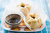 Baozi (steamed dough parcels, China) filled with pork