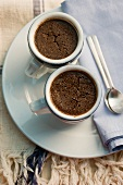 Baked chocolate pudding in coffee cups