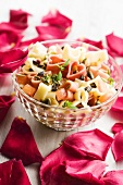 Colourful pasta salad with herbs and olives for Valentine's day