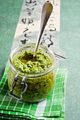 A jar of rocket pesto with garlic