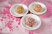 Sticky rice dumplings decorated with sesame seeds and sprinkles (Asia)