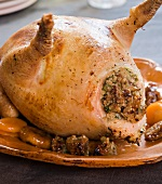 A spring chicken stuffed with quinoa and dried fruits under the skin