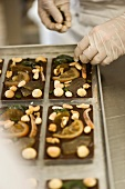 Preparing bars of chocolate with candied fruits and nuts