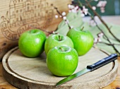 Four Granny Smith apples