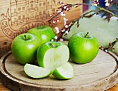 For Granny Smith apples on around chopping board