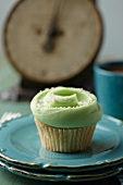 Frosted Mint Cupcake on Two Stacked Blue Plates