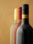 Three bottles of wine: red wine, rose wine and white wine