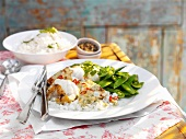 Monkfish with a coconut and chilli sauce on a bed of rice with mange tout