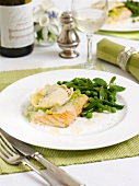 A salmon fillets with ravioli and vegetables