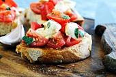 Bruschetta caprese (toasted bread topped with tomato and mozzarella)