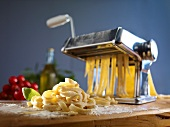 A pasta maker and fresh pasta