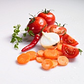 Freshly washed sliced carrots, onions, tomatoes, chilli peppers and chervil