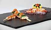 Prawn kebabs and King prawns on a slate plater
