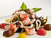Seafood Salad; Shrimp and Octopus Marinated in Olive Oil, Basil and Lemon; Garnished with Olives, Grape Tomato on a Bed of Spring Greens