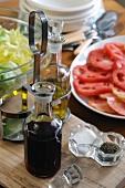 Vinegar, oil, salt and pepper for salad dressing