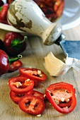 Sliced peppers and a mezzaluna knife in the background
