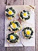 Mini spinach and quail's egg pizzas