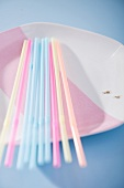 Drinking straws on a plate