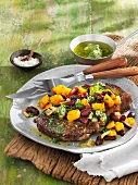 Beefsteak with herb butter, pumpkin and kidney beans
