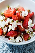 Strawberries with acacia flowers