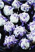 Cheese balls with ground ivy leaves and flowers