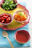 Ingredients for strawberry and melon salad with strawberry dressing