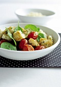 Tomato salad with baby spinach and hake