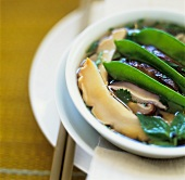Abalone soup made with dried mushrooms and mange tout (China)