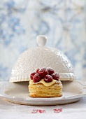 Puff pastry tartlet with vanilla cream and raspberries