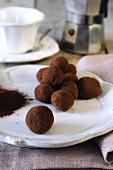 Handmade chocolate truffles and an espresso