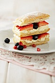 A cream and berry puff pastry tower