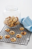 Apricot and cranberry biscuits on a wire rack and in a cookie jar