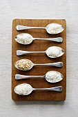 Various types of rice on spoons