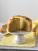 Partially Sliced Lemon Poppy Seed Cake on a Pedestal Dish