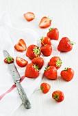 Strawberries, a tea towel and a knife