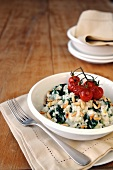 Spinach, gorgonzola and pine nut risotto topped with oven roasted cherry tomatoes