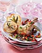 Chicken leg with herbs, scampi and potato chips