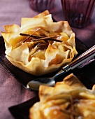 Puff pastry tartlets filled with apples