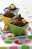 Chocolate mousse in colourful bowls