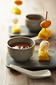 Exotic fruit kebabs with a chocolate dip