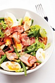 Bean salad with bacon and egg