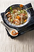 Oriental noodle soup with prawns and lychees