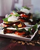 A tower of tomato, aubergine, mozzarella and basil